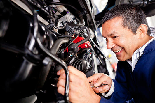 Car mechanic working at the auto repair shop